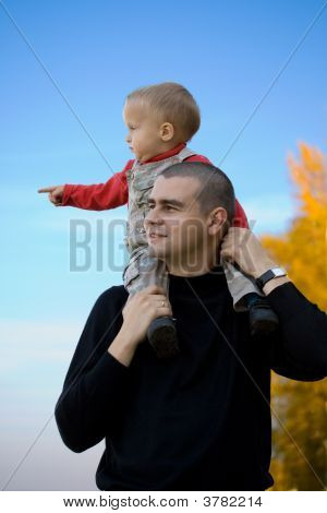 Boy Sitting On His Father\'s Shoulders