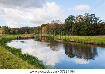 A Windless Autumn Day At A Narrow River