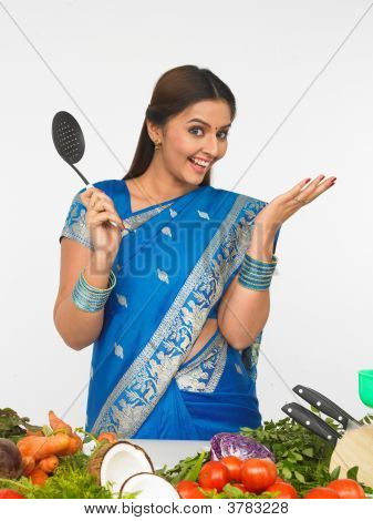 Woman With A Cooking Ladle, Ready To Cook
