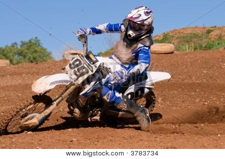 Motocross Rider Powering Out Of Corner