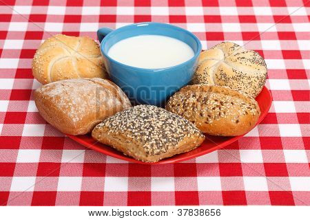 Milk In Cup And Various Rolls