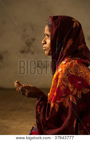 Poor Indian Female Beggar Side Profile Hands Out