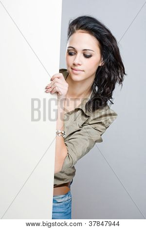 Brunette Woman Behind White Billboard.