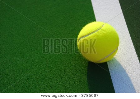 Yellow Tennis Ball On The Line