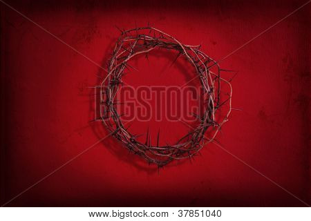 Crown of thorns on red textured background