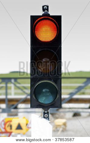 Traffic Light Signal Shows Yellow Light