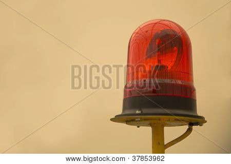 Red Beacon On Yellow Metallic Rod Warning