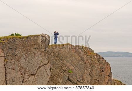 Nature Watcher On A Coastal Cliff