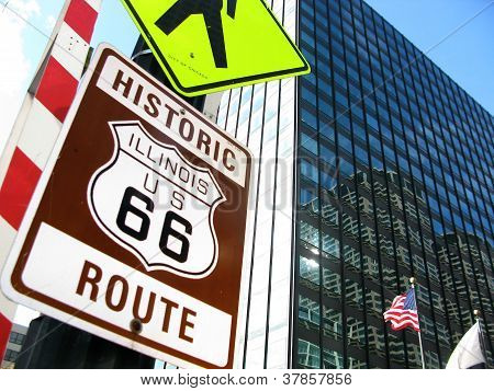 HISTORIC ROUTE 66 SIGN AND AMERICAN FLAG