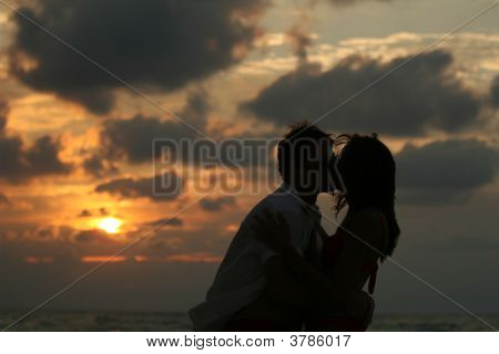 Kissing Couple By Sunset