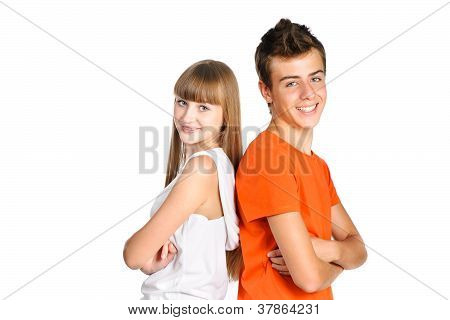 Portrait Of Teenager Boy And Girl Smiling Isolated Over White