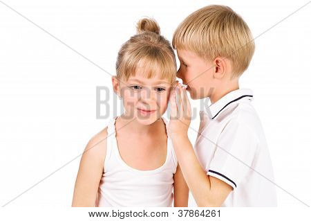 5-7 Years Old Boy Tells A Secret To The Girl Isolated Over White Background