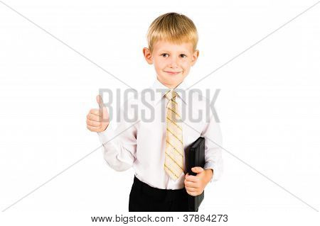 Portrait Of A Smiling Schoolboy Holding Pad With Thump Up Sign Isolated Over White