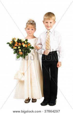 Beautiful Little Couple Of Kids Wearing Fancy Attire Isolated Over White