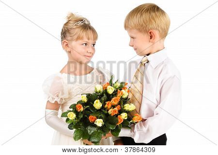 The First Love Concept. Beautiful Couple Of Kids With Flowers Isolated Over White