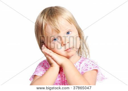 Little Blond Girl With Sleeping Hands Gesture Isolated Over White