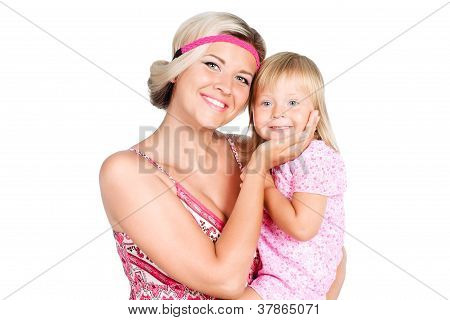 Portrait Of Young Mother Holding Her Daughter Face With Bright Smile Isolated Over White