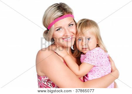 Portrait Of Beautiful  Mother Embracing Her Daughter Isolated Over White