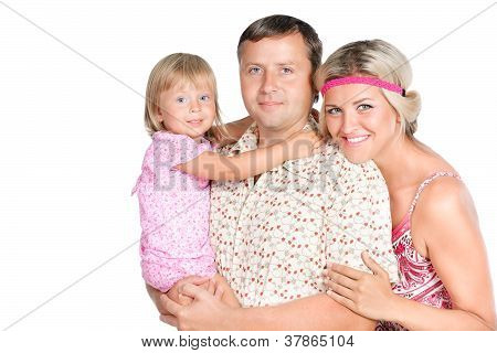 Happy Young Family With Pretty Daughter Posing On White Background