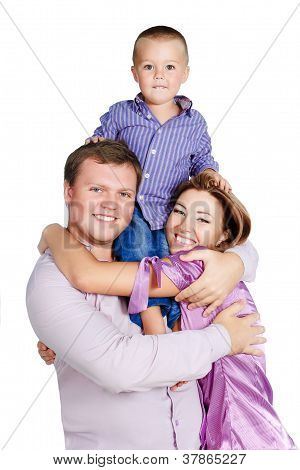 Happy Family With Boy 3-4 Years Old Hugging Together Isolated On White Background