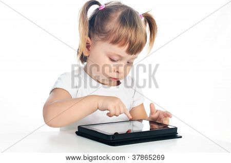 Serious 3 Years Old Girl With Tablet Isolated Over White