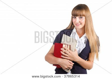 Portrait Of A Cute Young Student Girl With Books Isolated On White