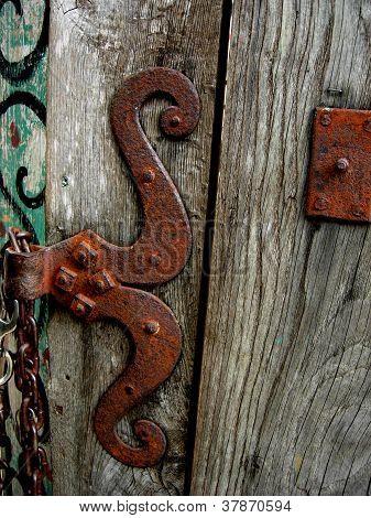 Rusty rustic weathered wooden door hinge