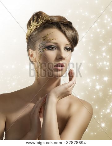 Pretty Girl With Christmas Decoration And Hand Near The Face