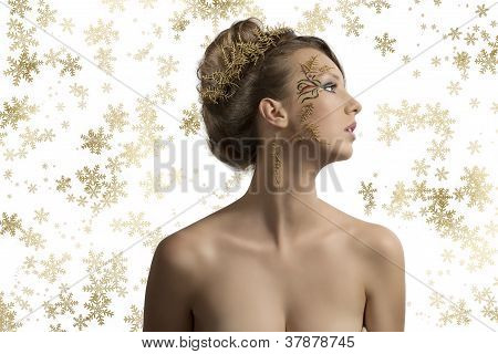 Pretty Girl With Christmas Decoration Looks At Left