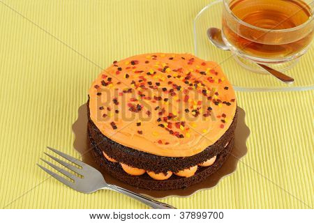 Orange chocolate cake with tea