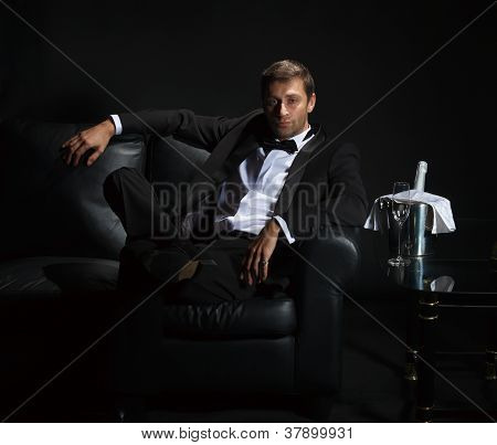 Sexy Man In Tuxedo Waiting For His Date