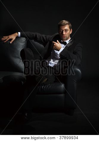 Handsome Man In A Tuxedo On Couch