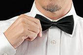 Man In Tux Straightens Bowtie, One Hand