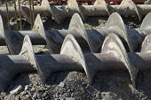 picture of auger  - augers used to dig deep foundations for a building - JPG