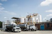 stock photo of toxic substance  - Chemical Industry Storage Tank And Tanker Truck In Industrial Plant - JPG