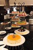 stock photo of banquette  - the Different kinds of cakes buffet banquette - JPG