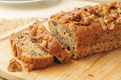 image of walnut  - Sliced banana bread with walnuts on a cutting board - JPG