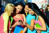 foto of intercourse  - group of female students chatting in social network on mobile phone - JPG