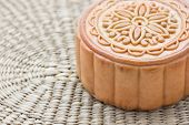 pic of customary  - Chinese moon cake on a bamboo plate - JPG