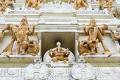 stock photo of vinayagar  - Ornate Hindu Ganesha God and Goddesses Temple Gopuram Tower Stone Statue Carvings Gorup - JPG
