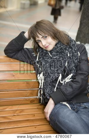Young Attractive Woman Sitting On Bench In State Department Store. Moscow