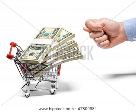 businessman's fig & steel grocery cart full of money stacks - isolated on white background