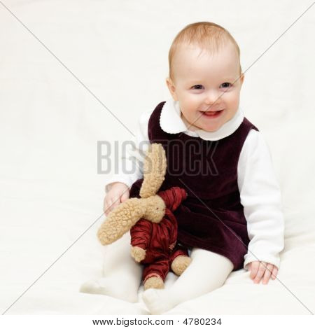 Infant With Toy
