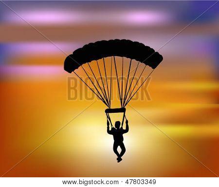 voando com o pára-quedas por do sol