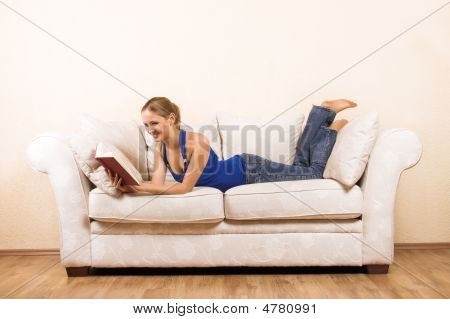 Woman Is Reading On A Lounge