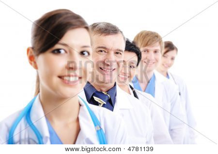 Doctor's Faces Looking At Camera