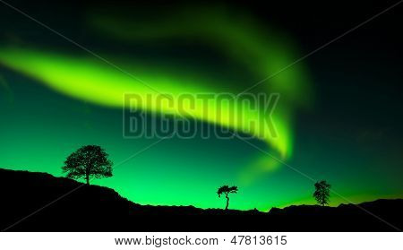 Northern lights Aurora borealis reflection on a lake in Iceland