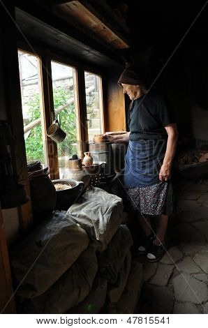 Old potter woman with a ceramic jug