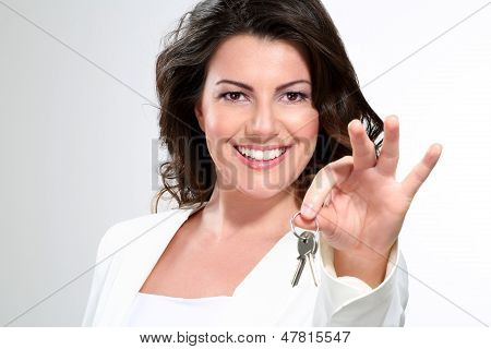 Young Beautiful Woman Showing  Apartment Keys