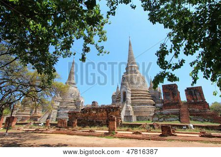 Old and ruined stately Chedi (Sri Lankan-styled stupas) at The largest temple in Ayutthaya - Wat Phra Si Sanphet, Thailand